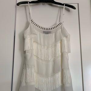 Cream blouse; fringe and silver embellishments